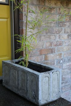 DIY concrete planter. Detailed instructions and molds for making large concrete planters.