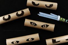 Glowing eyes in the bushes! Made with toilet paper rolls, glowsticks, and duct tape.