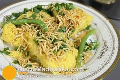Cook with less oil, steam baked, served with spicy desi chutney, chilly and sev famous and special Gujarati traditional street food surti locho is out of the world. Prepare it for breakfast or supper or whenever you like eating. Gujarati Cuisine, Gujarati Recipes, Indian Food Recipes, Asian Recipes, Gujarati Food, Ethnic Recipes, Veggie Recipes, Appetizer Recipes, New Recipes