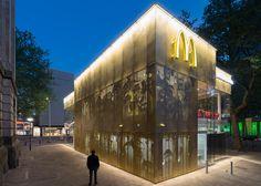 McDonald's restaurant has a golden facade and spiral staircase