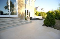 CGN used our Harvest Sawn Sandstone Paving and Bullnose Steps to create this beautiful patio design, blending effortlessly into the original design of the property. Paving Stones, Garden Design, Easy Landscaping, Front Garden, Patio Design, Sandstone, Limestone Patio, Patio Stairs, Garden Stairs
