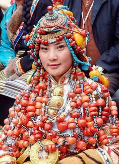 Tibet | An incredible collection of 'the most treasured beads in the world' - the black and white dzi - and red corals. At the King Gesar Arts Festival / Khampa arts festival in the Kham region of Tibet in 2004 some unbelievable costumes were put together from vast collections of ornaments. | © BetterWorld2010, via Flickr