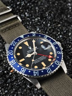 Rare blue bezel and all red 24hr hand on a vintage 1675 GMT. Never seen the blue bezel before. That's beautiful.
