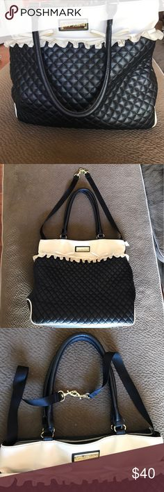 Betsy Johnson large tote satchel quilted bow bag The perfect carryall! This bag can fit ANYTHING! Even your beach towel should you so choose! It is NOT NEW. This bag has been well loved & the pics show the damage. The piping is cracked on the bottom on all corners & on handle, & the ruffle is dirty. I've never had it cleaned bc the dirt isn't noticeable so it didn't bother me, but I'm sure it's an easy fix. As for the cracking, it's only on the bottom & handle so again I didn't mind. Inside…