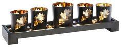 Artikeldetails:  Deko-Teller aus Holz in der edlen Optik schwarz und gold, Mit fünf Teelichthaltern mit Blatt Verzierung, Stilvoller Kerzenhalter mit Tablett,  Maße:  Maße (B/T/H): 37/10/10 cm,  Material/Qualität:  Aus Holz und Glas,  Wissenswertes:  Lieferung ohne Kerzen.,  ...