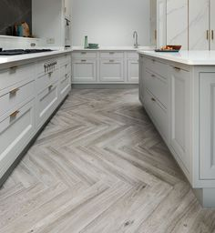 The New Deco kitchen is a new addition to our luxury kitchen collection. It draws inspiration from Art Deco designs. See more of the stunning New Deco kitchen. Custom Kitchens, Bespoke Kitchens, Geometric Lines, Kitchen Collection, Art Deco Design, Cladding, Tile Floor, Clever, Marble
