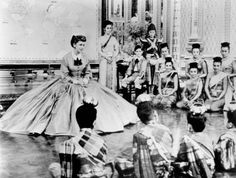 The King and I (1956) Deborah Kerr as Anna Leonowens #CostumeDesign: Irene Sharaff Anna teaching the wives  children of the King of Siam