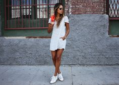 le Stripes. - Dress: Reformation  Wrap-around sweater: Equipment  Sneakers: Isabel Marant  Sunglasses: ASOS