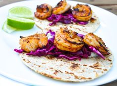 Chipotle shrimp tacos with citrus red cabbage slaw and cilantro lime yogurt sauce