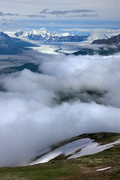 Photography Phil Armitage -   View toward the distant peaks and glaciers at the head of the Knik River Valley,  from the slopes of Pioneer Peak. Incredibly, this wild scene in the Chugach  mountains is only half an hour's drive from downtown Anchorage.