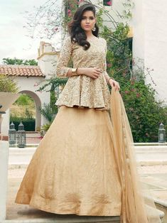 Redefined cream embroidered gown online at best shopping price. Shop this latest gown style for diwali celebration. This alluring style set comprises a net gown with matching net dupatta and silk bottom.