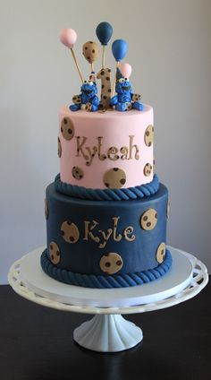 Twins 1st year Birthday Cake with Cookie Monster Theme. Navy blue and soft pink with chocolate chip polka dots and matching balloons.