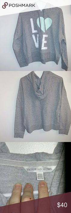 Victoria's Secret cropped hoodie sweatshirt Gray Victoria's Secret cropped hoodie sweatshirt never worn in perfect condition, except for a little wrinkles LOL. NWOT Victoria's Secret Tops Sweatshirts & Hoodies