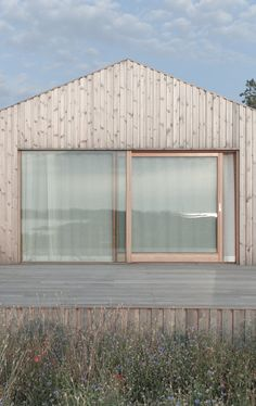 Villa Vassdal is a minimal home located in Gothenburg, Sweden, designed by Studio Holmberg Modern Wooden House, Wooden House Design, Island Villa, Storey Homes, Minimal Home, House Roof, Cladding, Villas, Facade