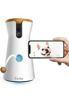 """(This is an affiliate pin) My heart breaks when I have to go to work every morning. Furbo to the rescue. It's the best dog camera!' - INSTYLE """"Why didn't I buy this sooner?"""" - BUZZFEED 'Furbo lets you find out the secret life of your dog.' - PEOPLE 'I'm convinced Furbo has improved my mental health."""" - TODAY """"Gorgeous. Simple & easy to use."""" - WIRED 'The Furbo Dog Camera just got even better with its new Furbo Dog Nanny!' - FORBES 'Furbo is the best treat-tossing pet camera' - GIZMODO The W... Holiday Fun, Holiday Gifts, Best Wifi, Pet Camera, Cat Feeder, Ear Warmer Headband, Graduation Quotes, Video Camera, Pet Gifts"""
