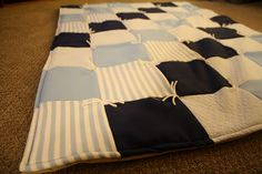 An easy tutorial to make a baby quilt. Great idea for a baby shower gift! by Black Little Button Blog. Check it out!