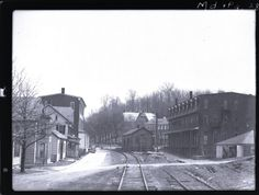 Station area at Yoe, where many homes and businesses faced on the railroad. The Mason Alley crossing is in the foreground. The track at right is the Yoe team track.