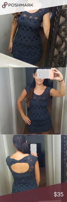 Free peolpe bodycon dress in navy! Size XS This free peolpe dress is adorable with cap sleeves and open cut out back. Its lined with a slip. The color is dark navy. Made with 70 % cotton, 26 % nylon and 4 % spandex. In excellent condition! Great for fall! Thanks for looking! Free People Dresses Mini