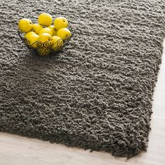 <li>Highlight your home decor with a hand-woven acrylic rug</li> <li>Casual rug is made of a comfortable, high-density weave</li> <li>Neutral background creates an alluring base for area rug</li>