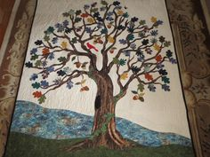 This is from the quilting board. Someone made this quilt as a memory quilt using her father's flannel shirts for the oak leaves & acorns. Beautiful!