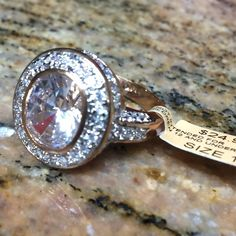 NWT! Gorgeous 14k Rose Gold Plated Halo Ring  Rose gold plated, 14k. Cubic Zirconia. Oval shaped with halo. Stunning! Too big for me :( NWT!!! You can't find this oval shape anymore, it's no longer listed, so get it here.  Jewelry Rings