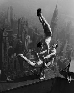 Acrobats perform a delicate balancing act on a ledge of the Empire State Building in New York City 1934