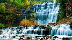 Anyone knows the name of this waterfalls? I assume people can walk across the base of falls. A handrail can be seen on the right, and a series of rocks is neatly arranged next to the handrail at the bottom of the falls. Famous Waterfalls, Beautiful Waterfalls, What A Wonderful World, Beautiful World, Beautiful Things, Places To Travel, Places To See, Photo Online, Pretty Pictures
