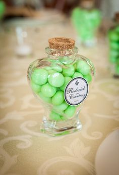Our favours were spearmint scotch mints in heart shaped jars   (my husbands favorite). The color of the mints is what decided our wedding color.