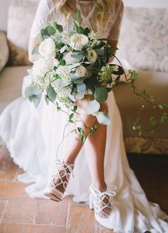 The perfect pair of shoes completes any wedding day look. Get creative by incorporating your bouquet into the pre-wedding pictures!