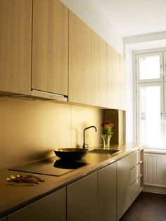 Beautiful brass kitchen by Minale + Mann