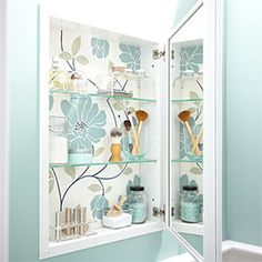 Splurge on a wallpaper pattern you really love and surprise yourself every time you open the medicine cabinet.