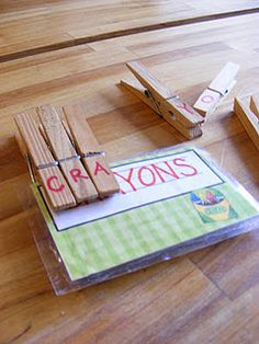 Spelling words w/clothespin letters.