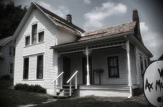 Villisca Ax Murder House in Villisca, Iowa. In 1912, this house was the scene of a grisly murder. Josiah and Sarah Moore, their four children, and the young Stillinger sisters, who were visiting, were all viciously murdered with an ax. Creepier still, the murderer left uneaten food out, covered each victim's face with a cloth, and draped linens over all mirrors and windowpanes. The case remains unsolved, but you can visit this house and stay overnight if you dare.