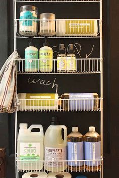 Hang an over-the-door rack on the inside of your laundry room door to store laundry and other cleaning supplies.