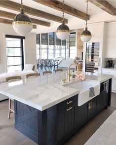 There's just something so inviting about the soul calming appeal of a country style kitchen! Farmhouse kitchen design tugs at the heart as it lures the senses with elements of an earlier, simpler time. Neutral tones lend a sense of… Continue Reading → Modern Farmhouse Kitchens, Farmhouse Kitchen Decor, Home Decor Kitchen, Kitchen Interior, New Kitchen, Home Kitchens, Kitchen Lamps, Kitchen Lighting, Kitchen Modern
