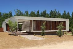 Besonias Almeida Arquitectos Design a Private Residence Nestled in the Woodland…