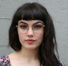 girl with glasses and nose ring