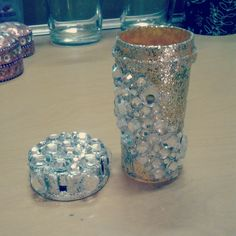Bejeweled pill bottle that was also painted with glitter paint. Now I use it to hold bobby pins.