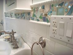bathroom deco out of sea glass and broken plates and little mirrors and such!!  I love sea glass something about the little tumbled unique pieces of glass.