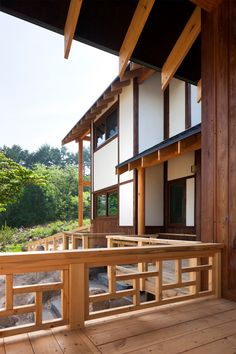 Seoul architects Studio GAON designed this house near Geochang for a couple who want to retire and grow walnuts. Porch Railing Designs, Balcony Railing Design, Concrete Stairs, Diy Porch, Patio Furniture Sets, Japanese House, Image House, Log Homes, Interior Architecture