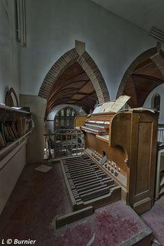 Abandoned Pipe Organ in church.