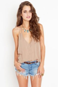 nude silky tank, turquoise necklace, light colored denim cutoffs