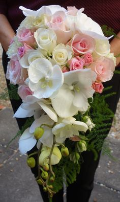 Cascading bridal bouquet of Phalaenopsis Orchids with pink and white roses - flowers by Christine of Sunpetals