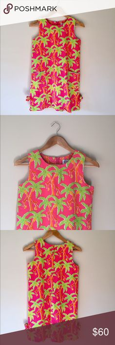 """Lilly Pulitzer Dress This adorable monkey banana print is hard to find! Kids size 14, fits me like a 0. 29.5"""" long, 16.5"""" chest laying flat. Great condition 🐒   Ships from Hawaii 🌺 No trades 😇 Reasonable offers welcome 👍🏻 Lilly Pulitzer Dresses"""