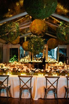 Elegant Wedding Reception with Moss | photography by http://www.kristynhogan.com/ close up of the moss and grapevine spheres