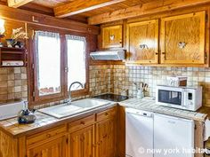 The cozy country cottage kitchen, otherwise known as ground zero for tasty snacks. Try for yourself in this #furnished #vacation #chalet in the #French #Alps.