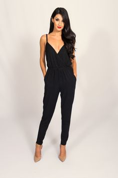 "LUCCA COUTURE BLACK METALLIC JUMPSUIT | Metallic thread throughout Deep v-neckline Sleeveless Spaghetti straps Side pockets Elasticized waist Main: 70% Nylon,23% Polyester, 7% Spandex Lining:65% Rayon, 35% Polyester Our Model wears an XS and is 5'8"" Measurements: Bust:32"",Waist 25"",Hips 33"""
