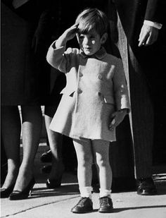 John F. Kennedy Jr salutes his father's coffin