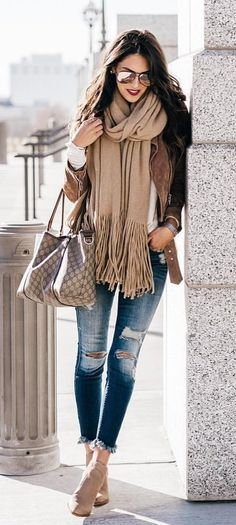 #winter #outfits  brown suede zip-up jacket with brown fringe edge scarf and blue denim jeans
