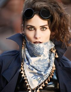 steampunk blue cape, blue scarf and goggles. This would be a lot easier to do than others.